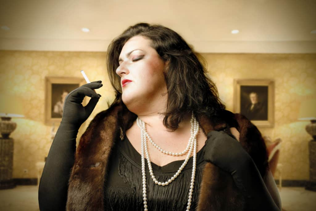 Beautiful rich woman with a snobby affect smoking a cigarette. Why are people snobby about art?