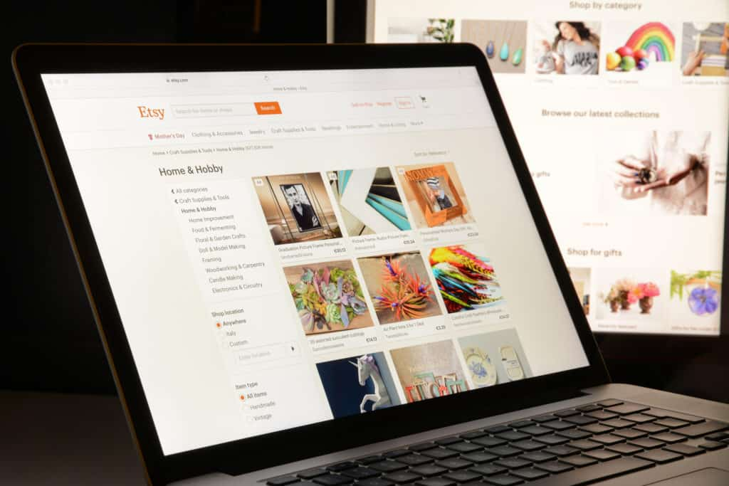 Laptop showing an Etsy shop where you could buy art from emerging artists.