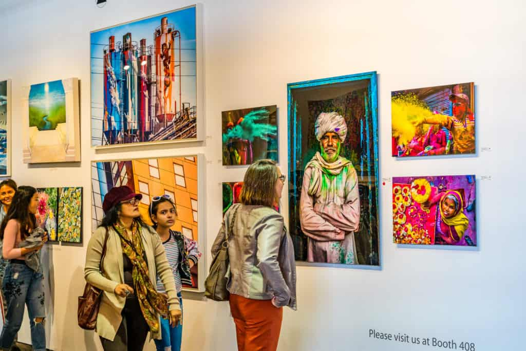 Woman viewing the work of an emerging artist at an art show in New York.