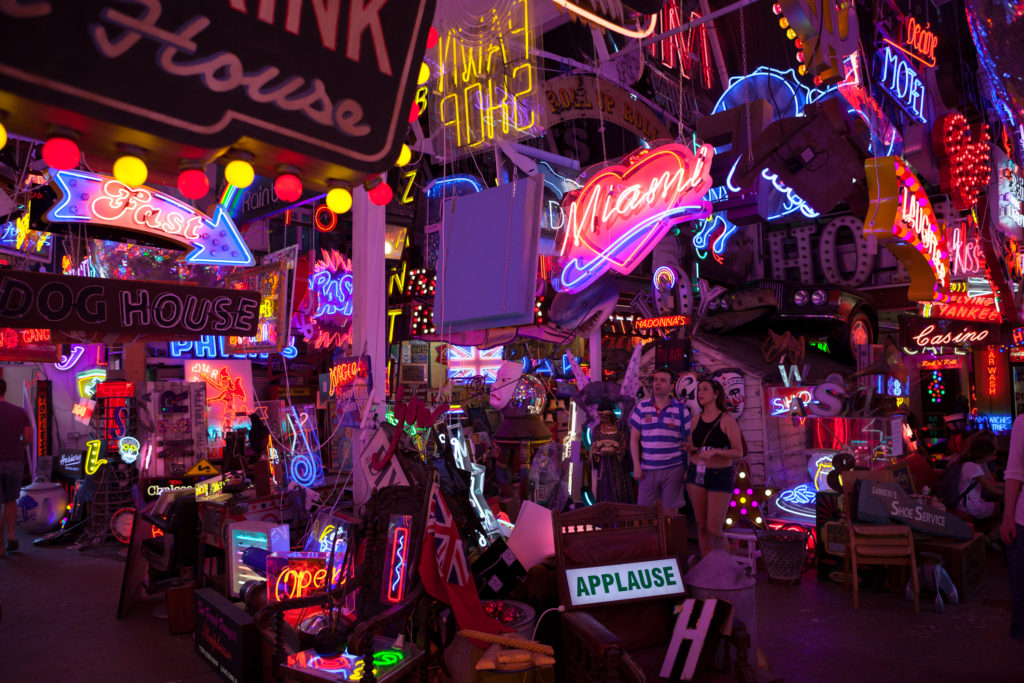 Inside God's Own Junkyard gallery in London displaying thousands of neon signs