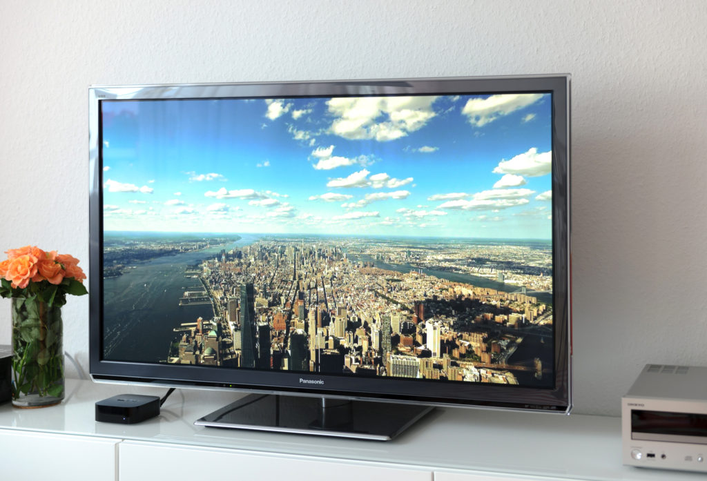 Smart TV showing a beautiful aerial photograph of Paris.