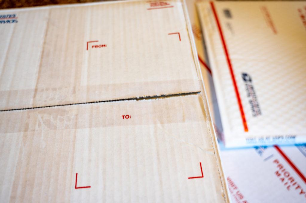 USPS white shipping box.